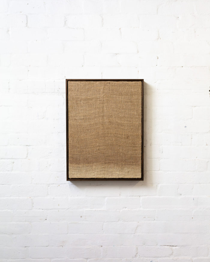 Transfer, 2020, hessian and bleach with artists frame, 61x46x4cm
